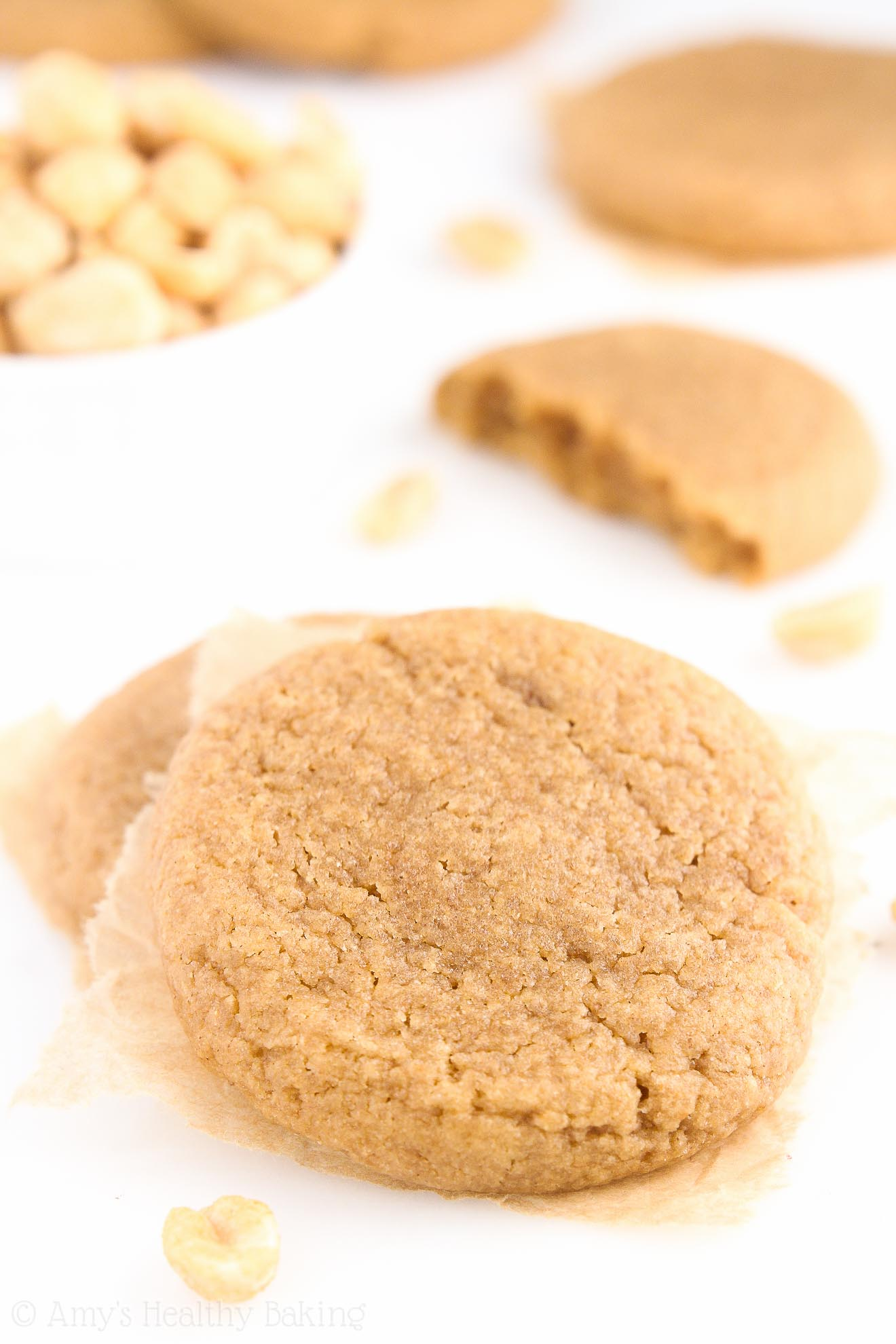 The ULTIMATE Healthy Soft & Chewy Peanut Butter Cookies -- these skinny cookies don't taste healthy at all! You'll never use another peanut butter cookie recipe again!