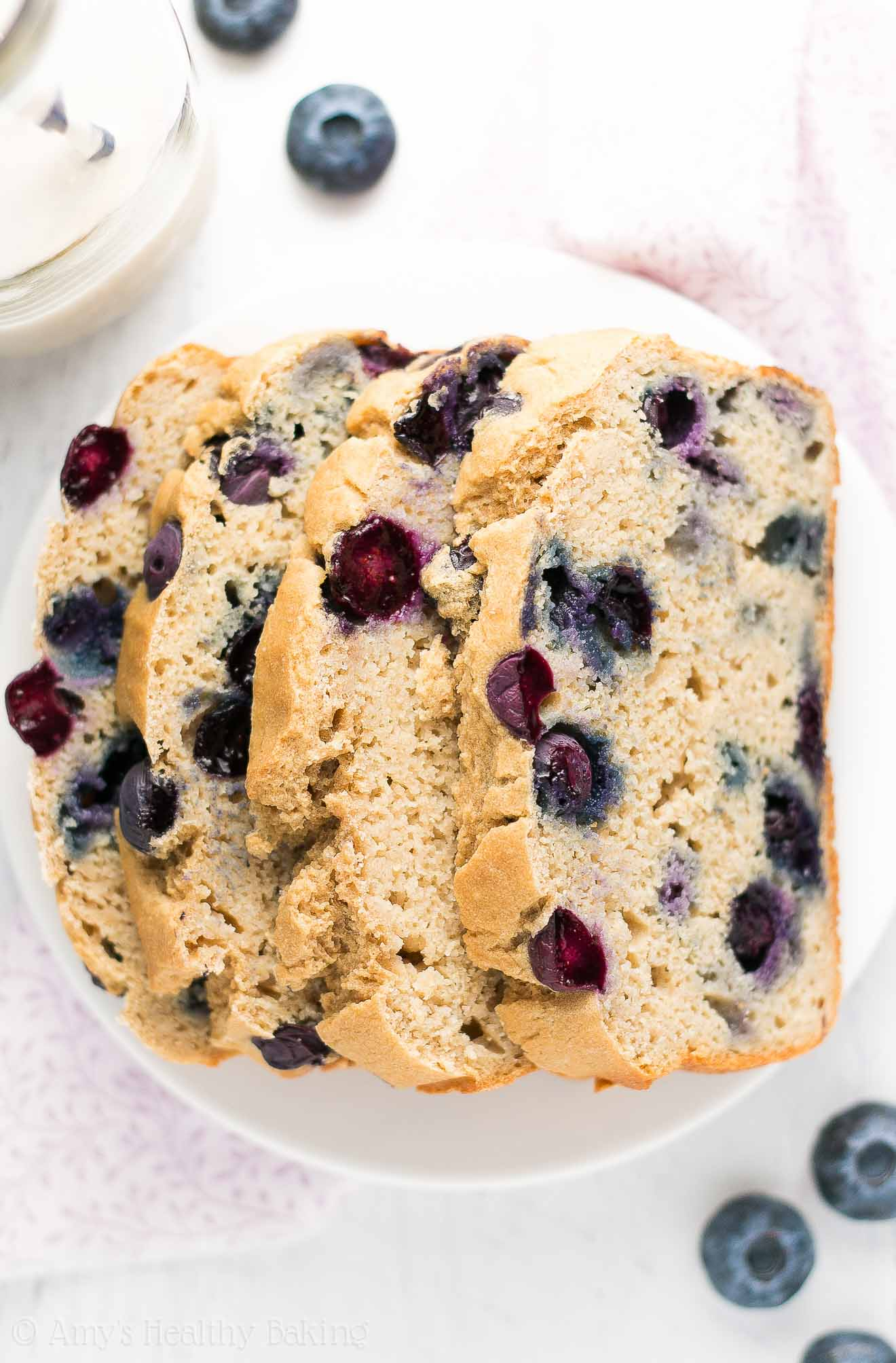 The ULTIMATE HEALTHY Blueberry Pound Cake -- so easy to make & only 134 calories! It's supremely tender, thanks to Greek yogurt! You NEED to try this incredible recipe!