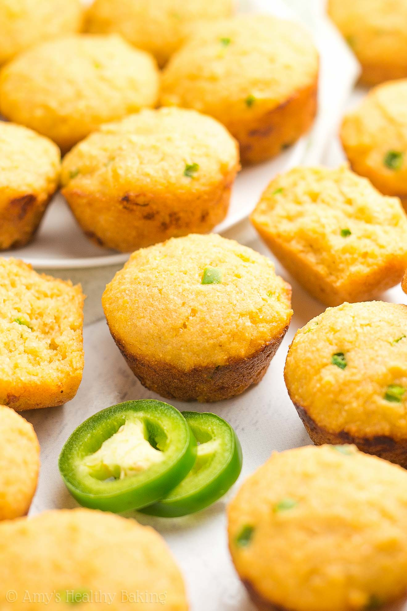 Healthy Jalapeño Cheddar Cornbread Mini Muffins -- only 49 calories! So easy, supremely tender & the perfect hint of heat. Guaranteed to be the BEST cornbread you'll ever eat! #healthy #recipe