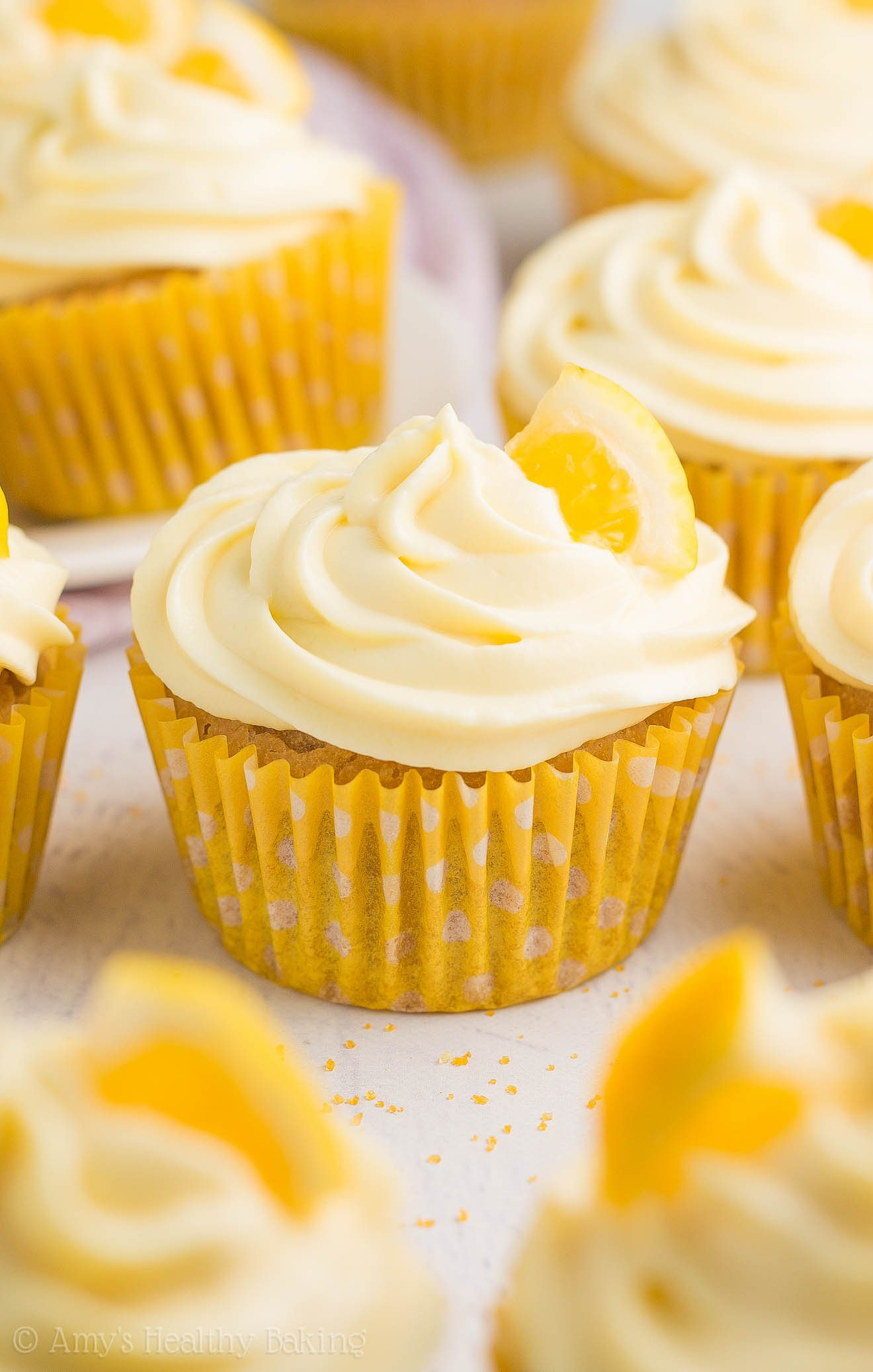 Healthy Lemon Cupcakes -- only 128 calories, including the frosting (it's made from Greek yogurt)! So easy & full of sweet, bright sunshiny flavor!