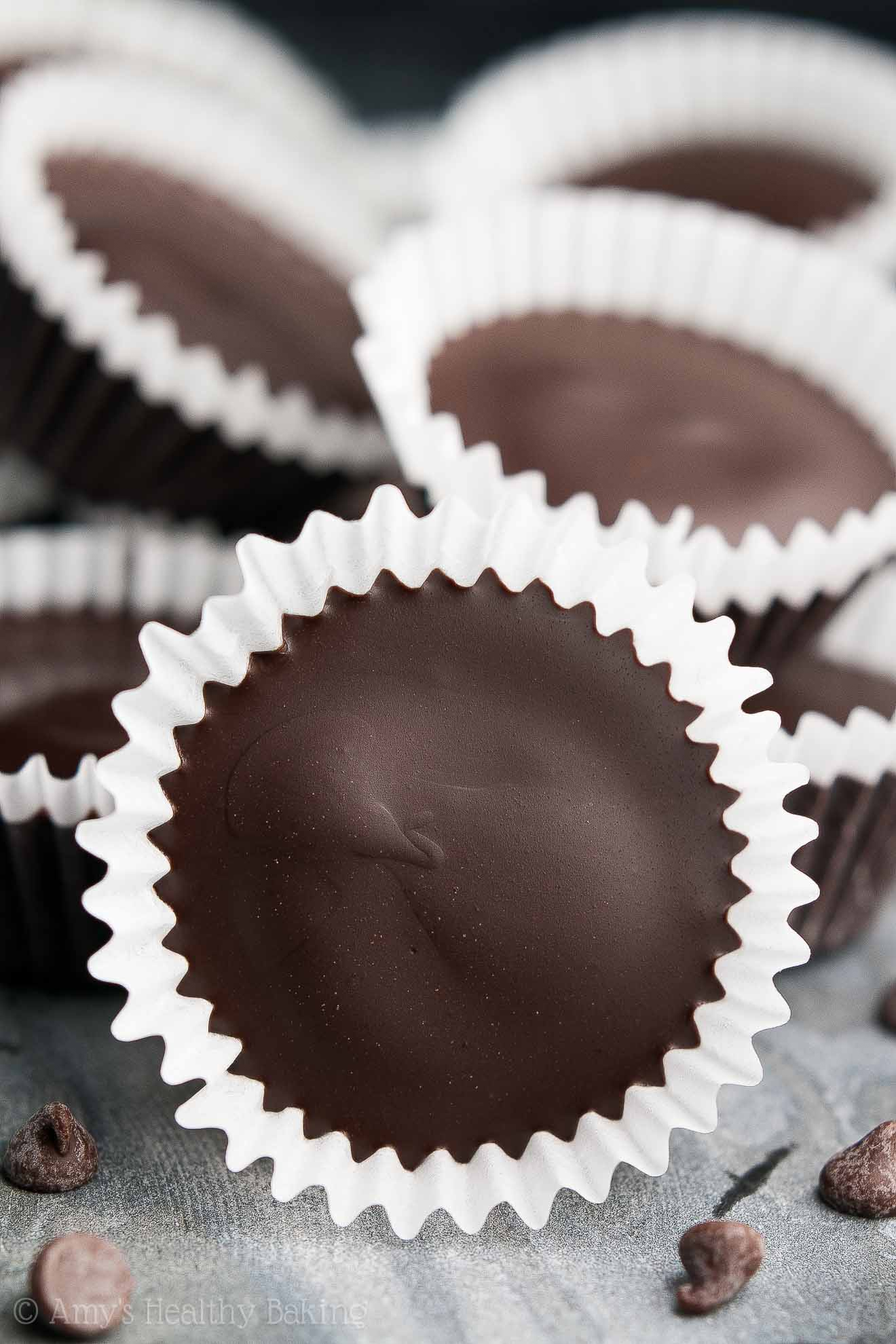{HEALTHY!} Pumpkin Spice Peanut Butter Cups -- only 40 calories! They're INSANELY GOOD!! Easy to make & WAY better than regular Reese's! I keep a big batch in my freezer. They're SO perfect for chocolate & candy cravings!