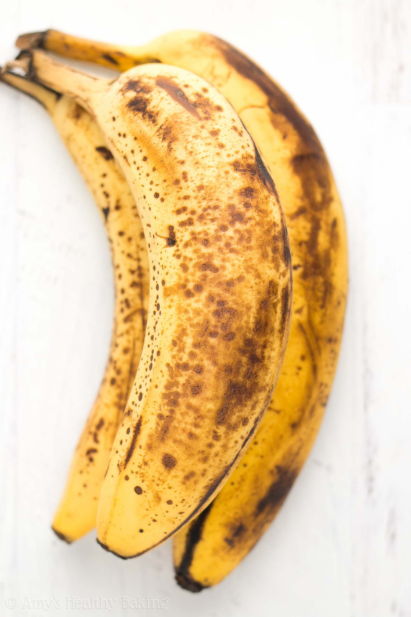 Three very ripe bananas that are perfect for baking