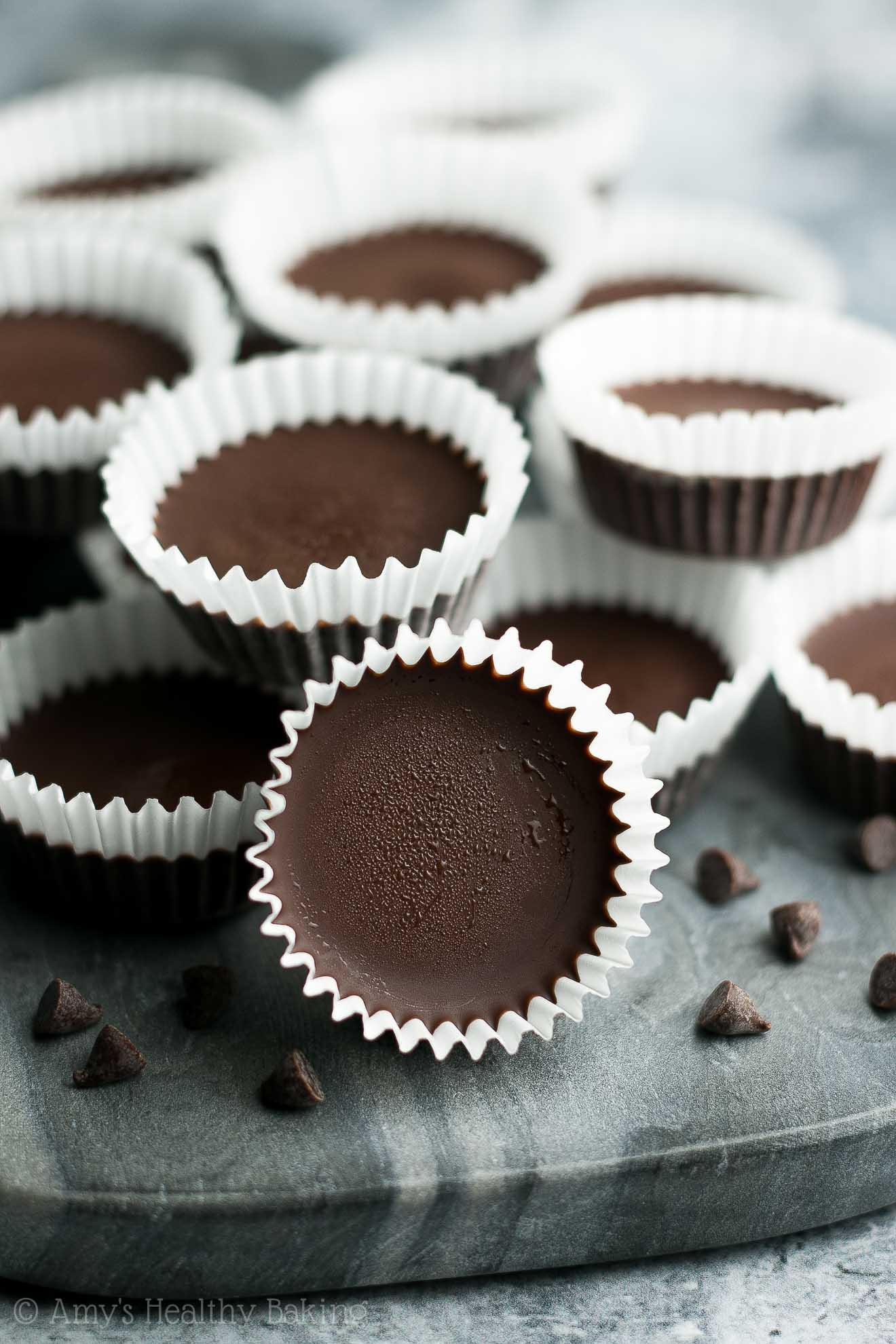 """{HEALTHY!} Chocolate Chip Cookie Dough """"Peanut Butter"""" Cups -- only 45 calories! They're INSANELY GOOD!! WAY better than regular Reese's! (Because you can't beat egg-free flourless cookie dough filling!!) I keep a big batch in my freezer. They're SO perfect for chocolate & candy cravings! #recipe"""