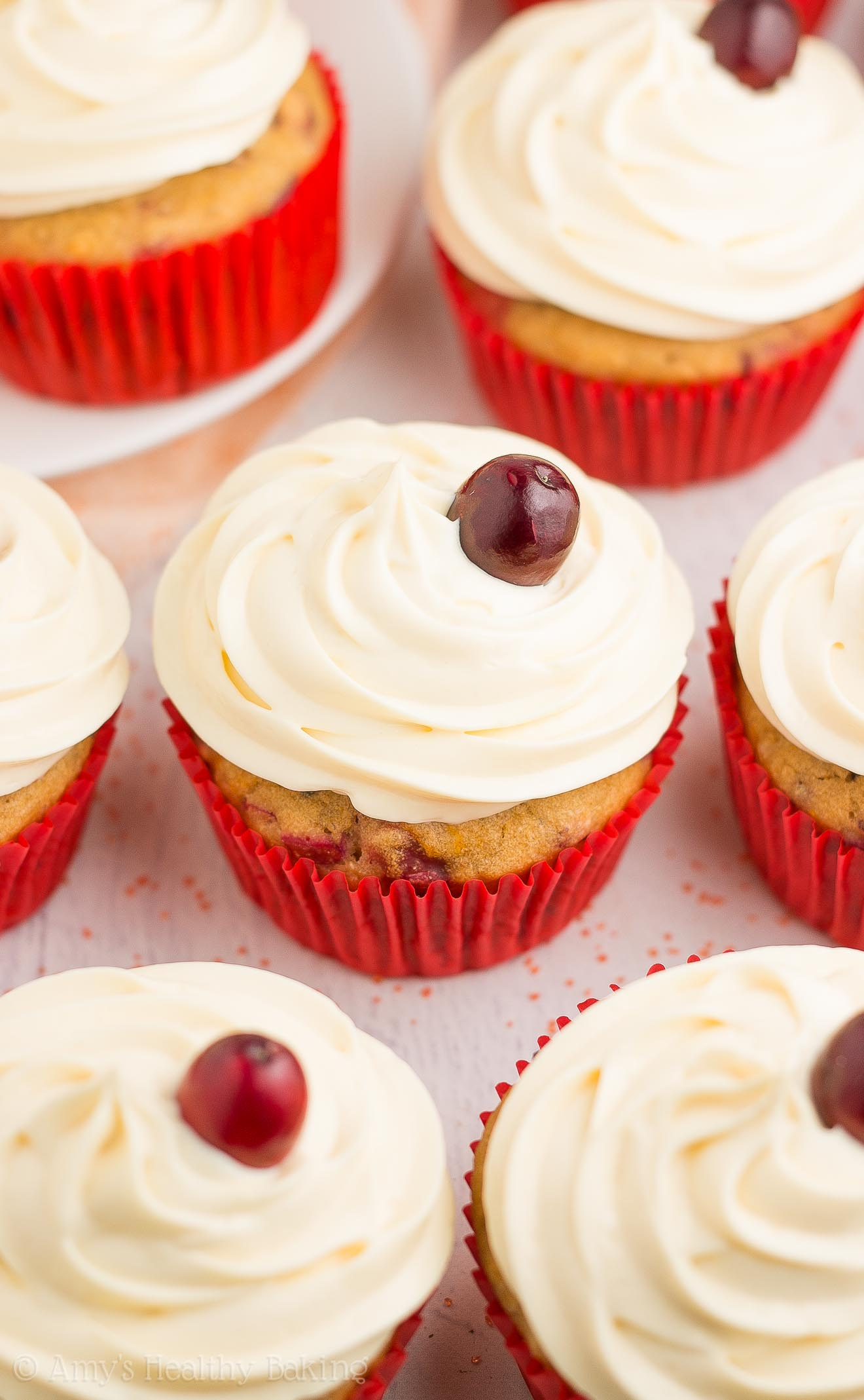 {HEALTHY!} Cranberry Orange Cupcakes -- only 118 calories, including the cream cheese frosting! They taste AMAZING! One of my all-time FAVORITE cupcake recipes! (And the yummy frosting has NO butter or powdered sugar!) #healthy #recipe #glutenfree #cleaneating