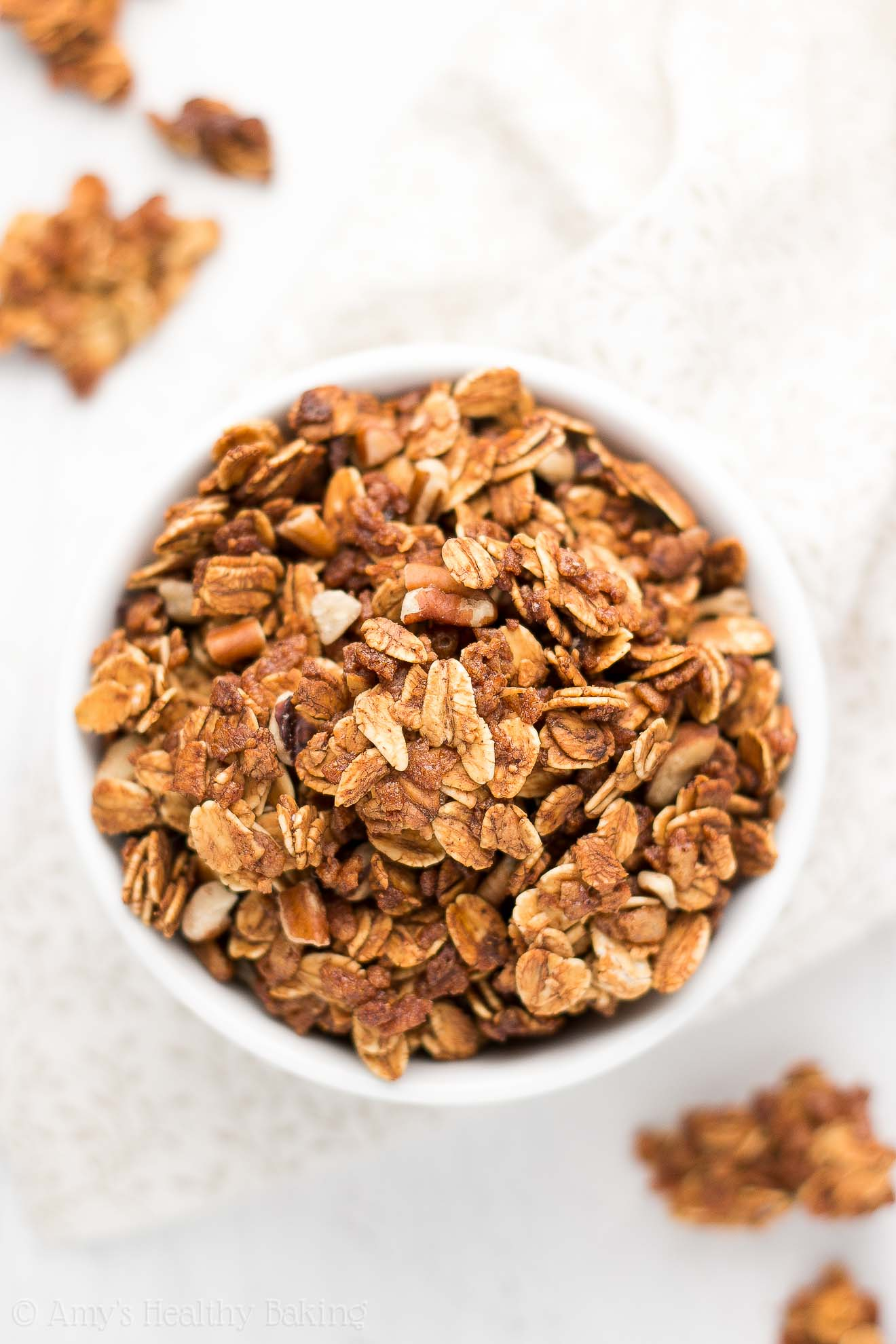 {HEALTHY!} Maple Pecan Granola -- only 7 ingredients & 139 calories! This one-bowl recipe is SO easy & tastes amazing! Plus a SECRET TRICK to getting those big, extra crunchy clusters!