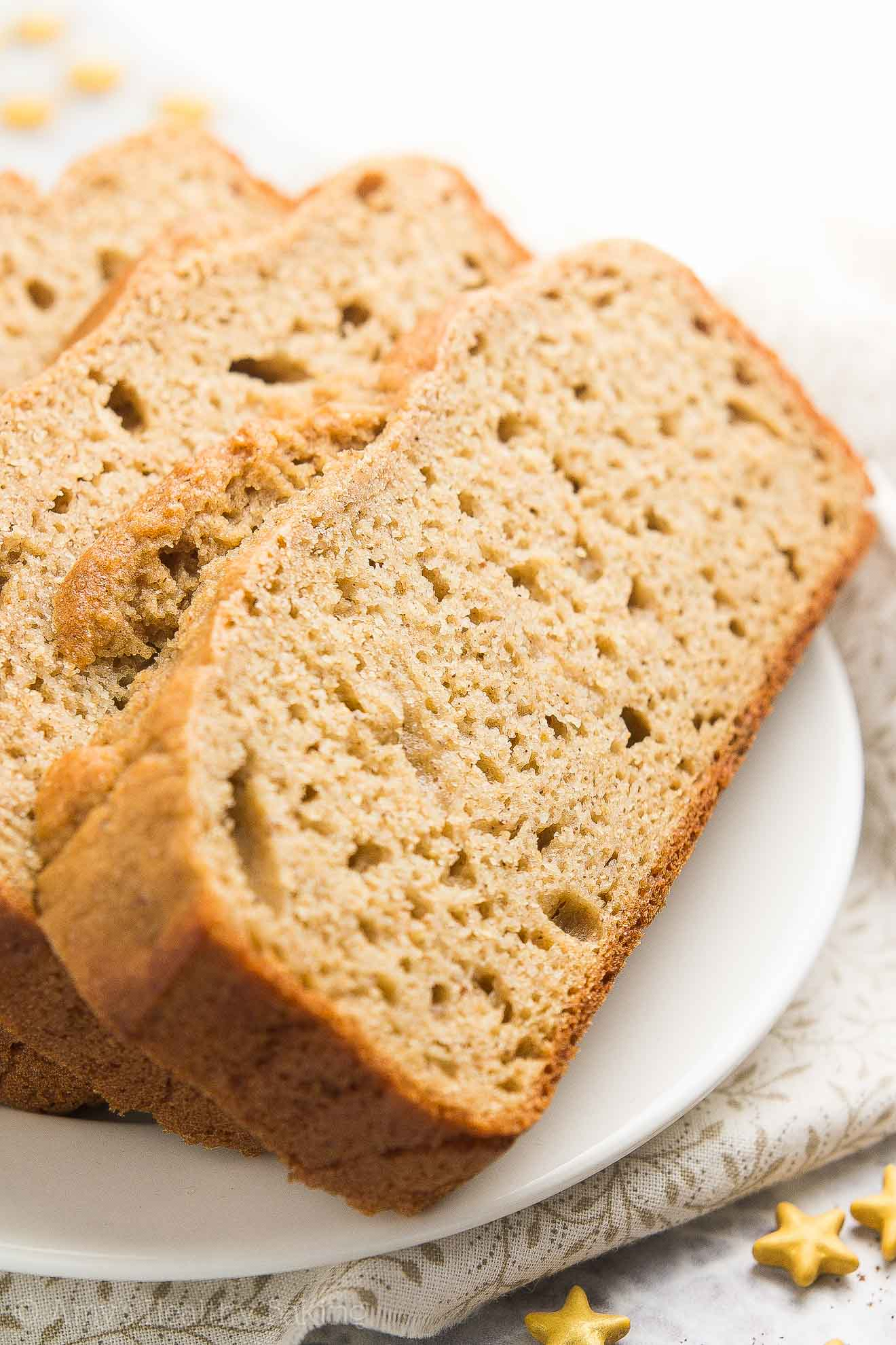 {HEALTHY!} Greek Yogurt Eggnog Pound Cake -- only 130 calories! This recipe is SO easy to make & full of sweet, cozy eggnog flavor! Perfect for Christmas & the holiday season! I make it multiple time every year -- it's THAT GOOD! #healthy #recipe #christmas #eggnog #cake #dessert #holidays