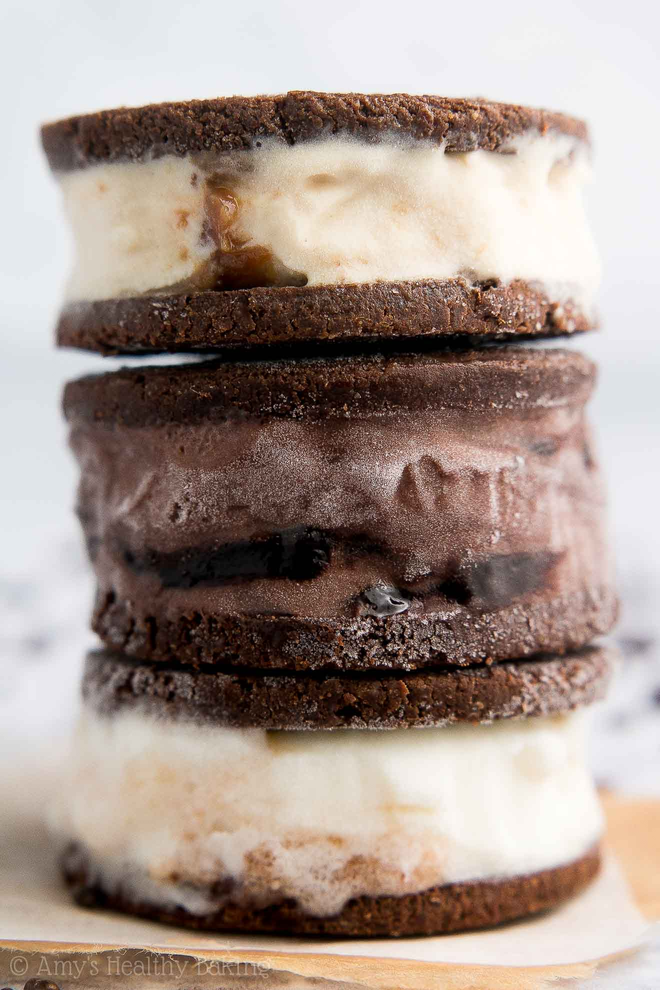 "{HEALTHY!} Brownie Bark Mini Ice Cream Sandwiches -- only 45 calories! They taste incredible! Sweet ice cream between fudgy brownie ""crusts"" = YUM!! I keep a batch in my freezer at all times! #eatenlightened #healthy #recipe #dessert #icecream"