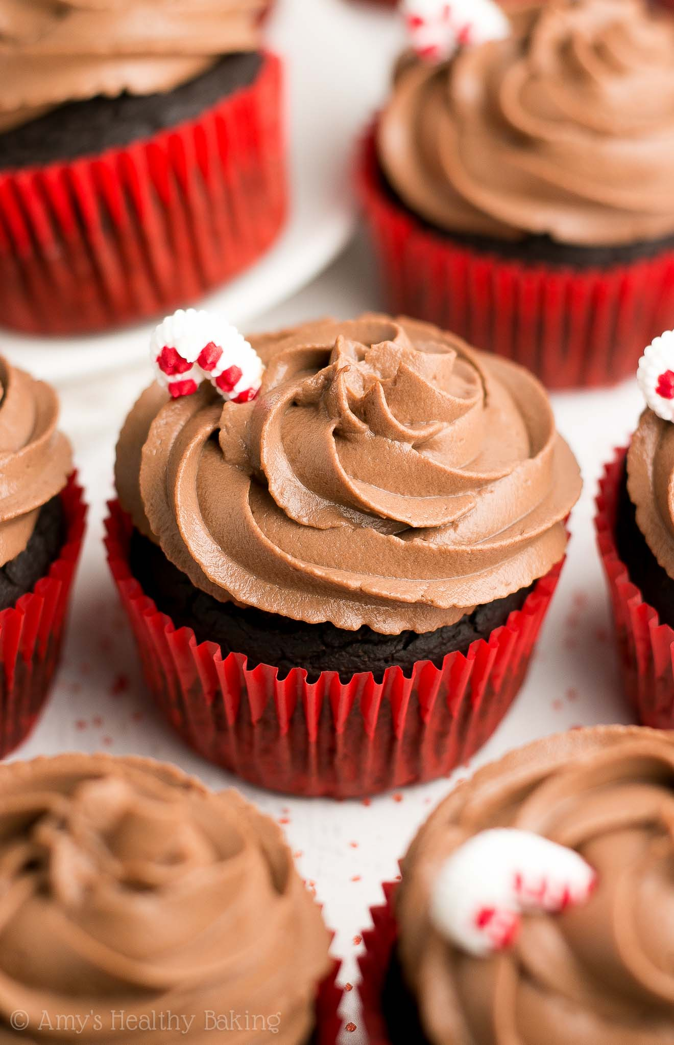 {HEALTHY!} Peppermint Mocha Cupcakes -- so rich, just like the Starbucks drink, but ONLY 96 calories! (Including the protein-packed frosting!) Such an easy & yummy holiday dessert recipe! #healthy #cleaneating #holidays #christmas #recipe #cupcakes #peppermintmocha