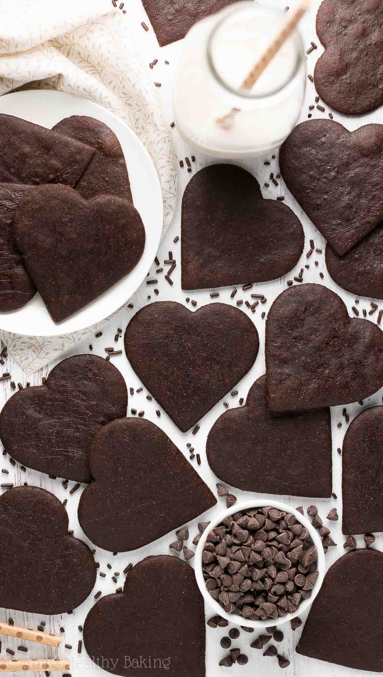 The Ultimate Healthy Chocolate Sugar Cookies - overhead picture of heart-shaped cookies surrounded by chocolate sprinkles