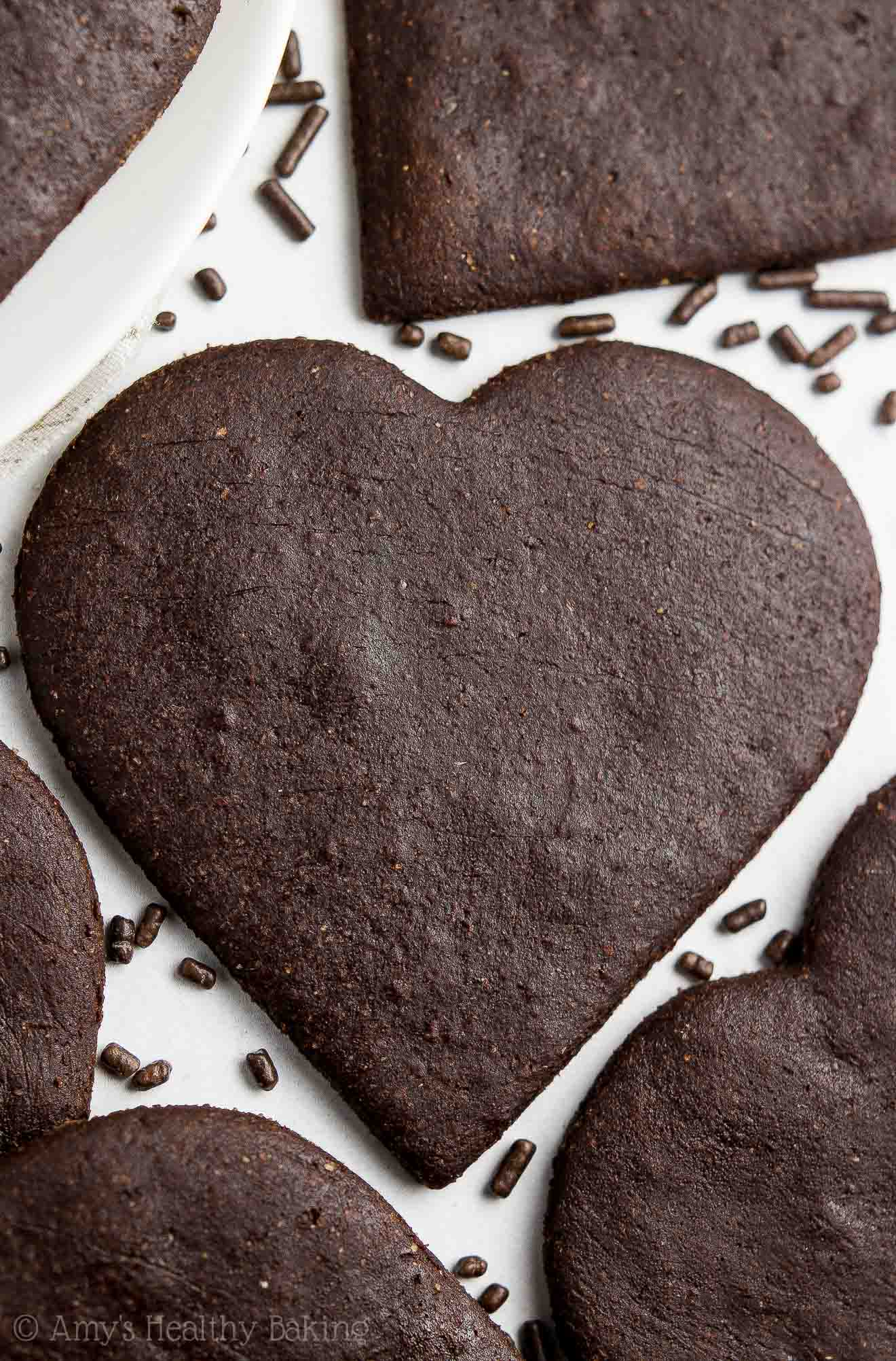 Close-up of soft dark chocolate sugar cookies in heart shapes and surrounded by chocolate sprinkles