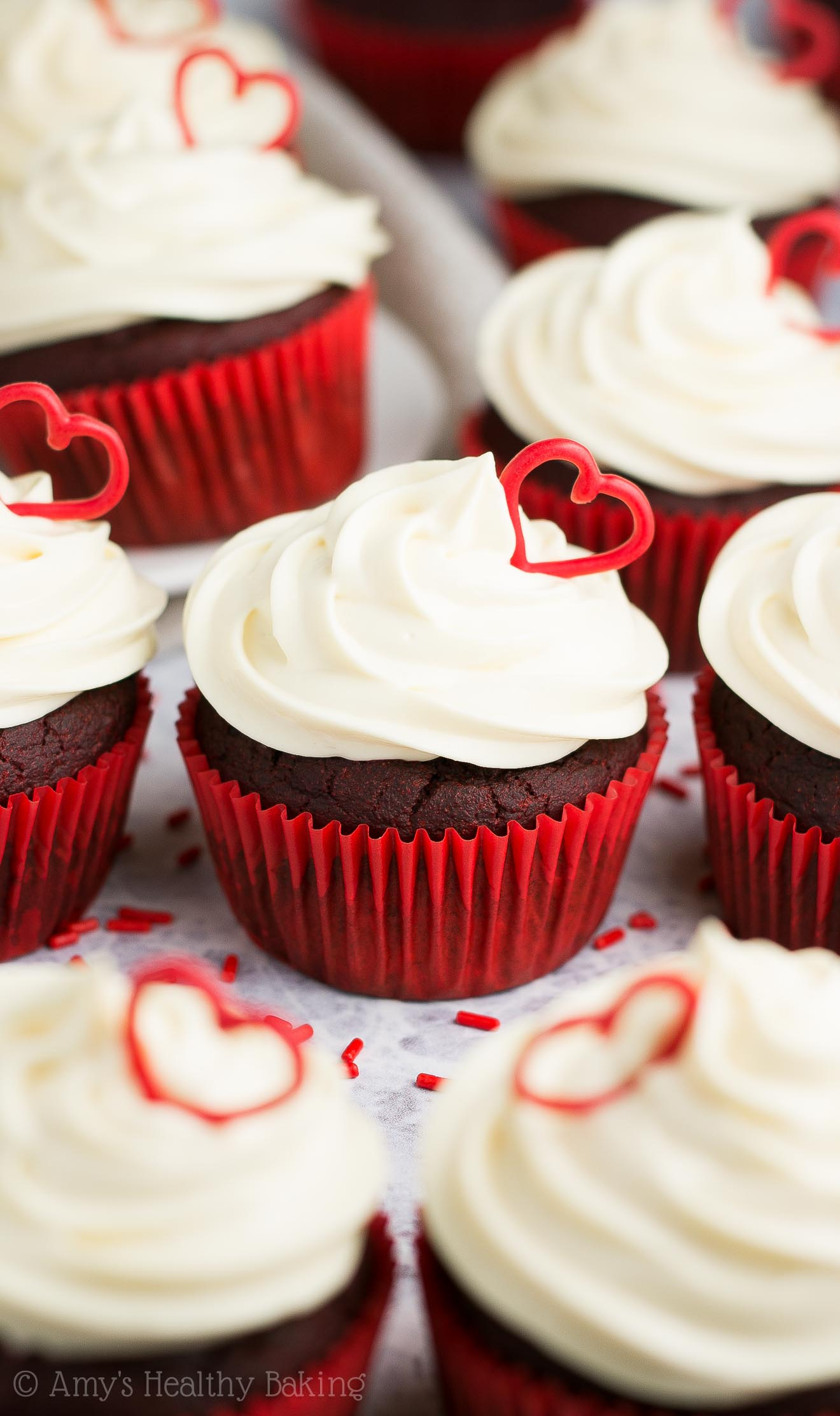 The ULTIMATE Healthy Red Velvet Cupcakes with cream cheese frosting + red heart decorations