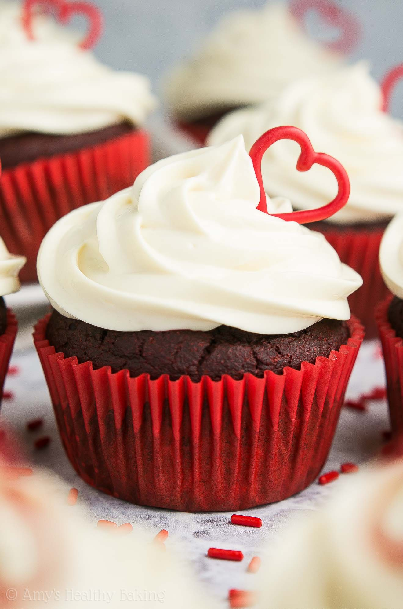 The ULTIMATE Healthy Red Velvet Cupcakes, topped with cream cheese frosting