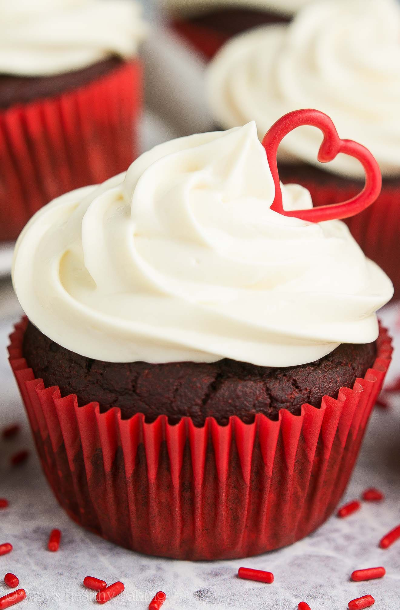 The BEST Healthy Red Velvet Cupcakes, topped with lots of cream cheese frosting