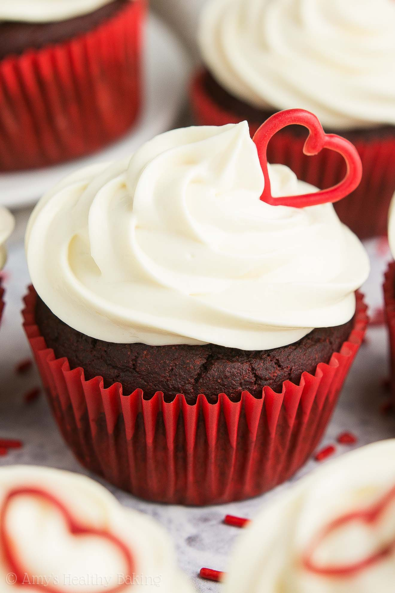 The ULTIMATE Healthy Red Velvet Cupcakes, topped with sweet cream cheese frosting