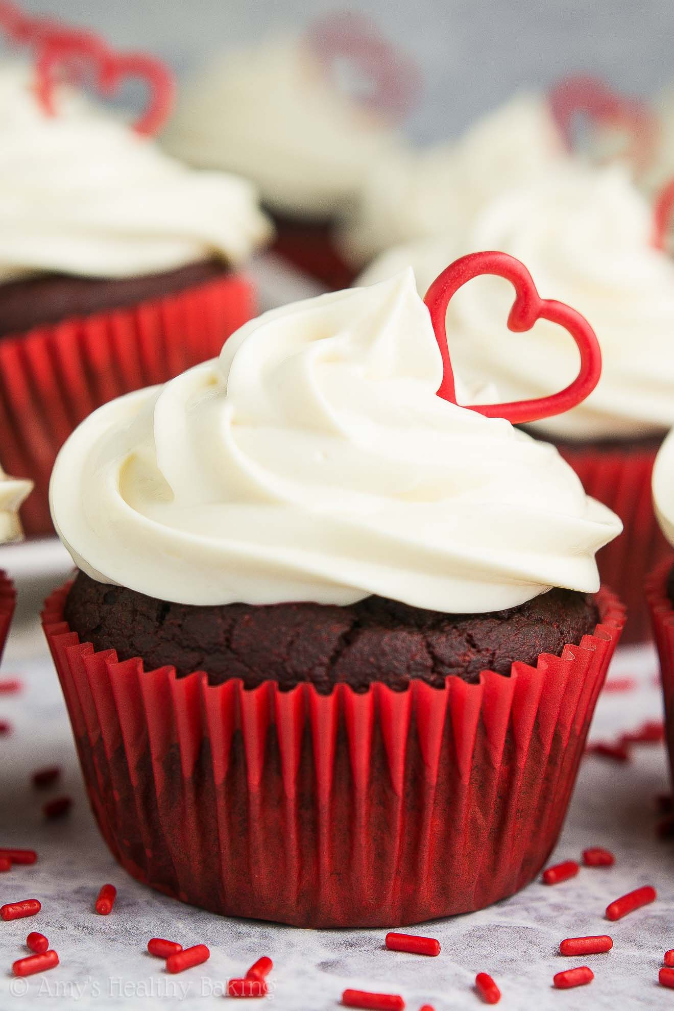The ULTIMATE Healthy Red Velvet Cupcakes! With cream cheese frosting + red heart decorations!