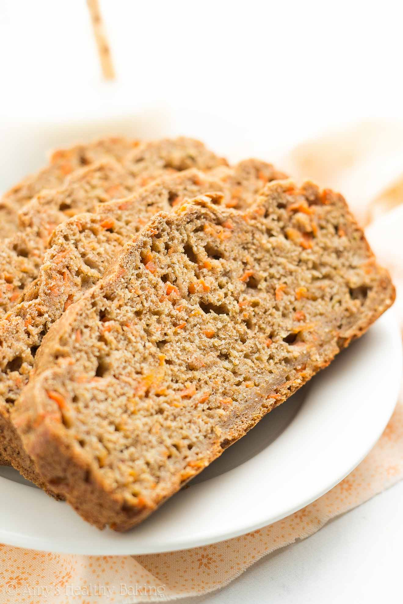 A plate with four slices of Healthy Carrot Cake Banana Bread