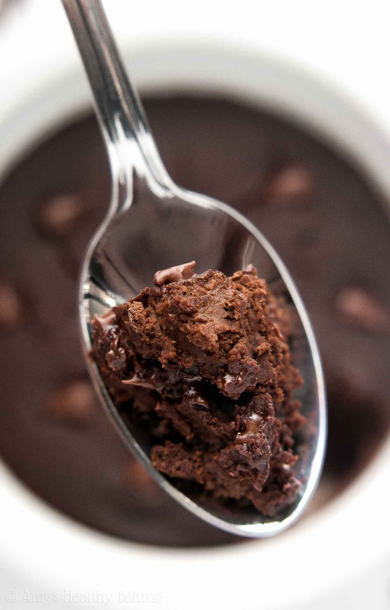 a spoonful of the best healthy flourless chocolate mug cake with lots of chocolate chips