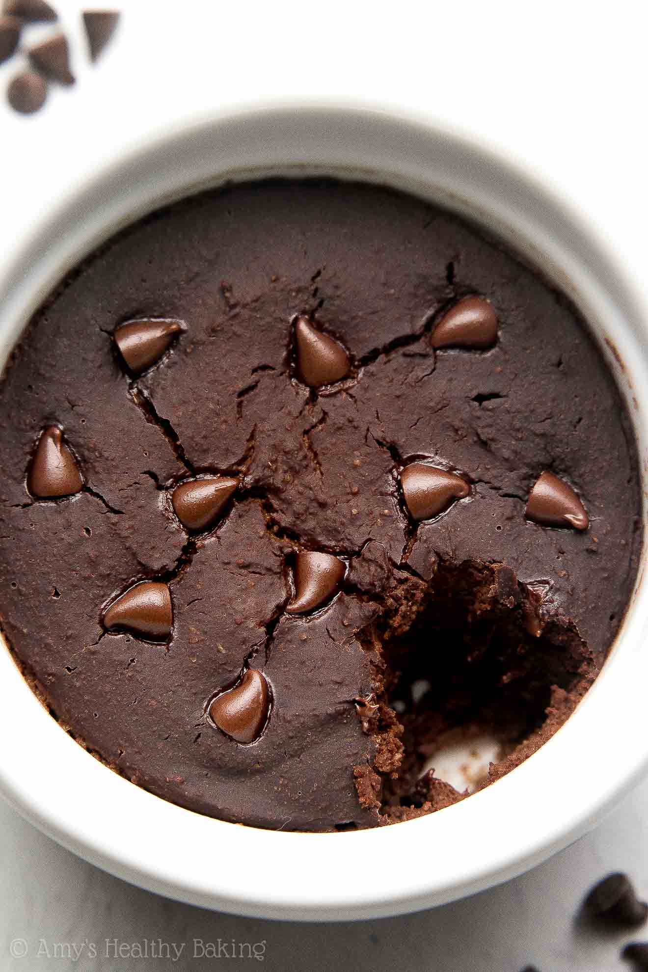 Healthy Flourless Chocolate Mug Cake with a bite missing