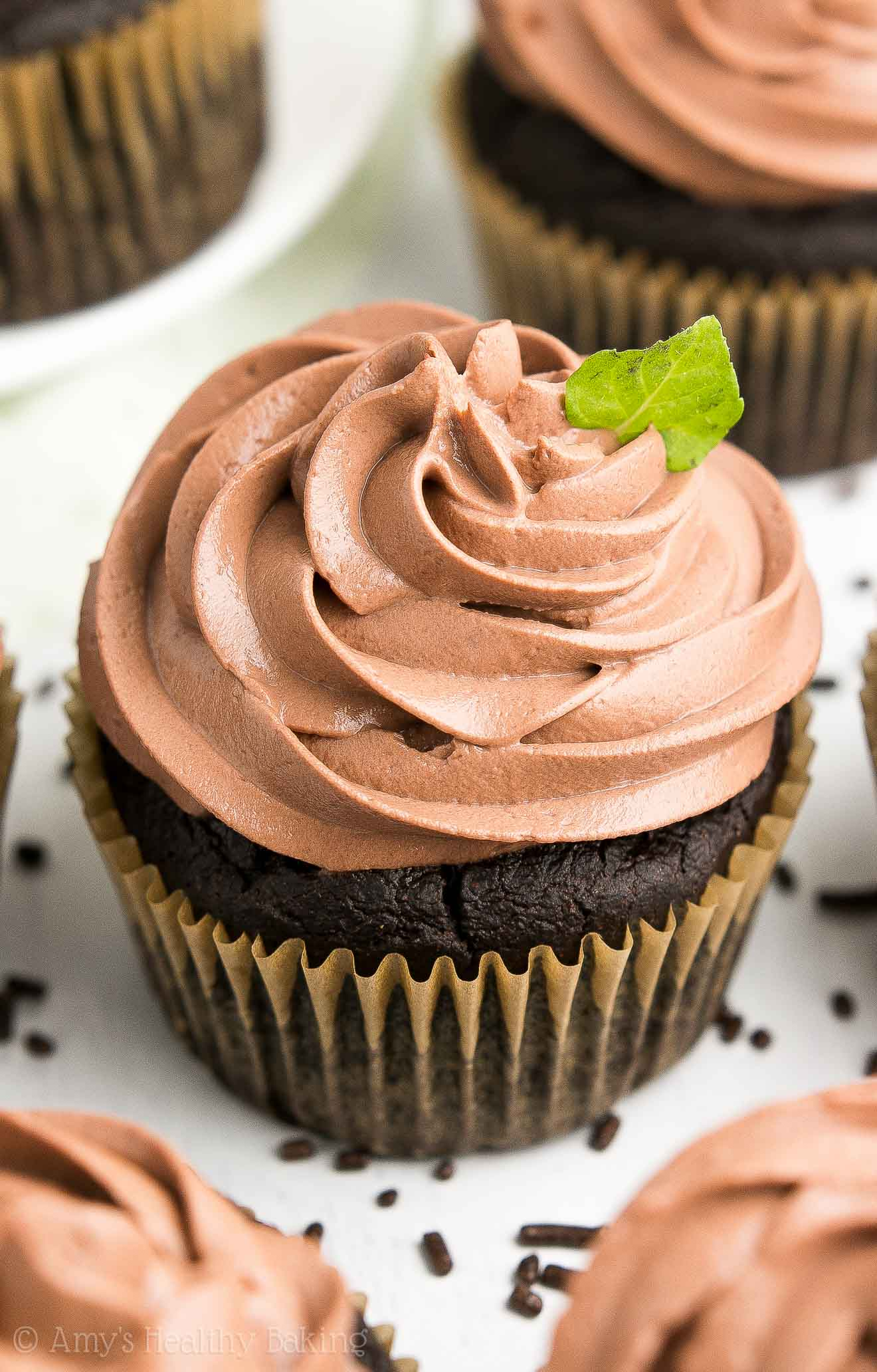 Chocolate Greek Yogurt Frosting piped on top of Healthy Mint Chocolate Cupcakes
