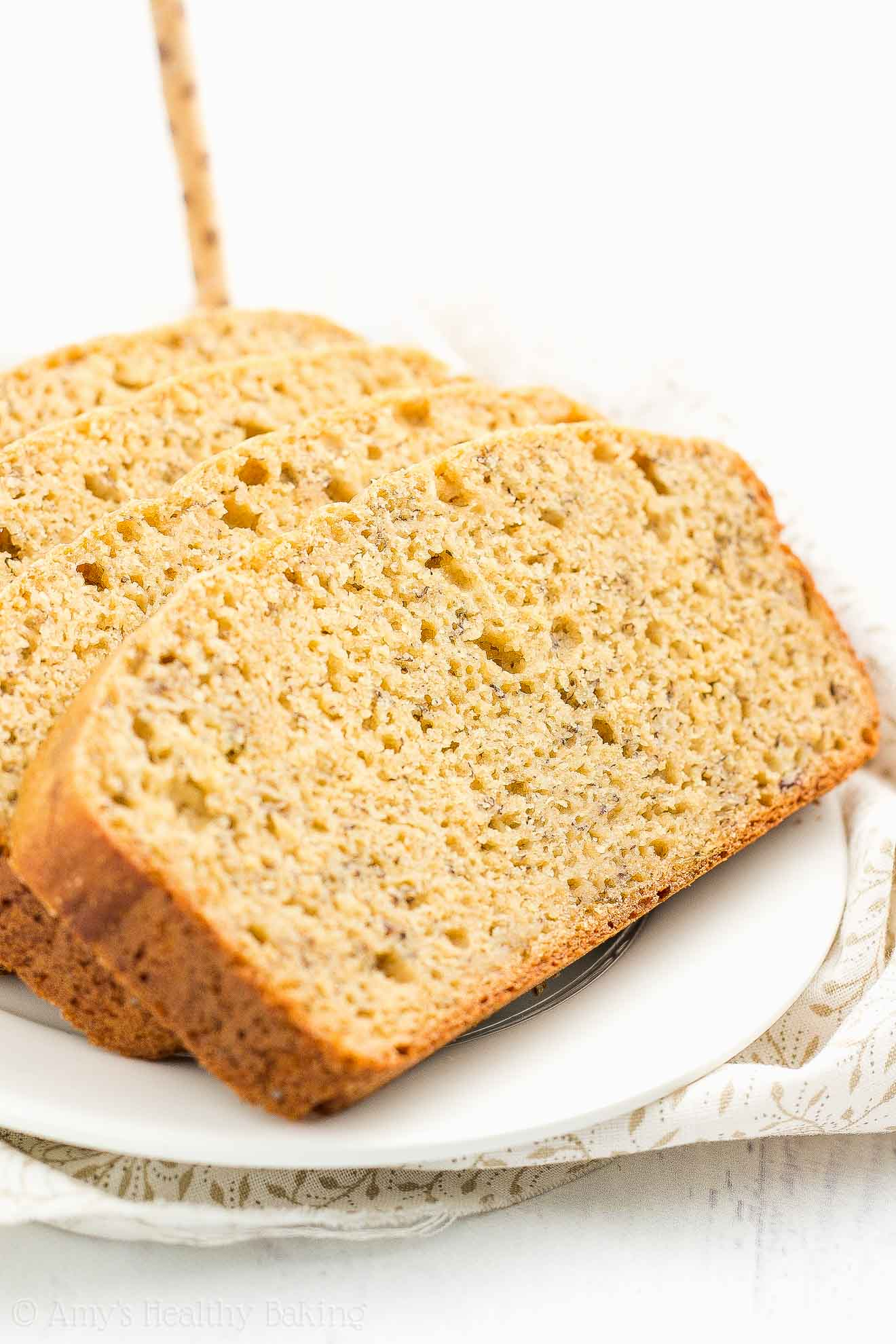 Slices of the ULTIMATE Healthy Banana Bread, made with Greek yogurt and really tender