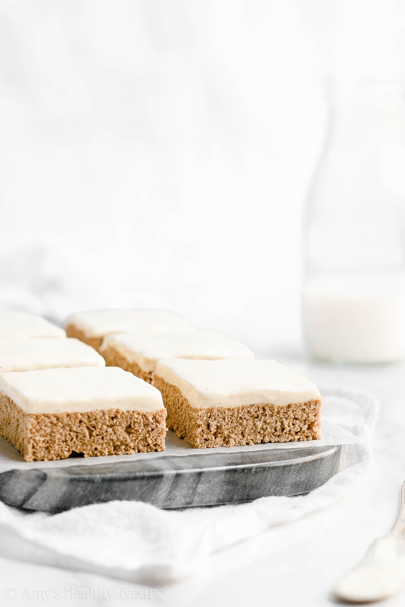 Clean Eating Healthy Cinnamon Roll Cookie Bars with Cream Cheese Frosting