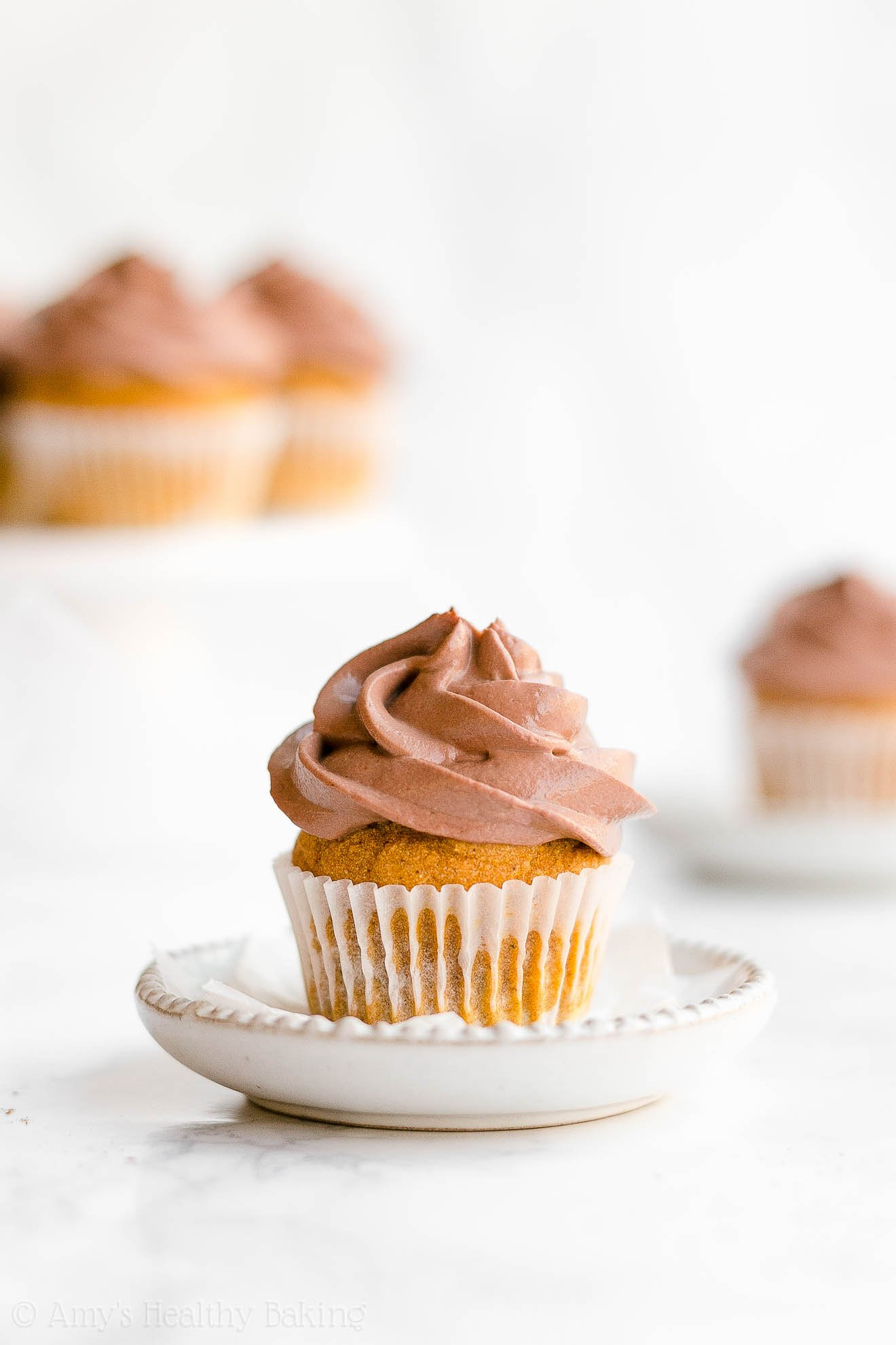Healthy Small Batch Mini Pumpkin Cupcakes with Chocolate Greek Yogurt Frosting