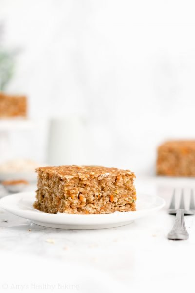 Healthy Carrot Zucchini Oatmeal Snack Cake – moist, tender & only 97 calories! This easy recipe is perfect for meal prepping breakfasts & snacks! It's always a huge hit at my house. Even my picky eaters love this! ♡ low calorie clean eating carrot zucchini oatmeal snack cake. greek yogurt carrot zucchini snack cake with gluten free and whole wheat options. simple homemade diy snack cake recipe.