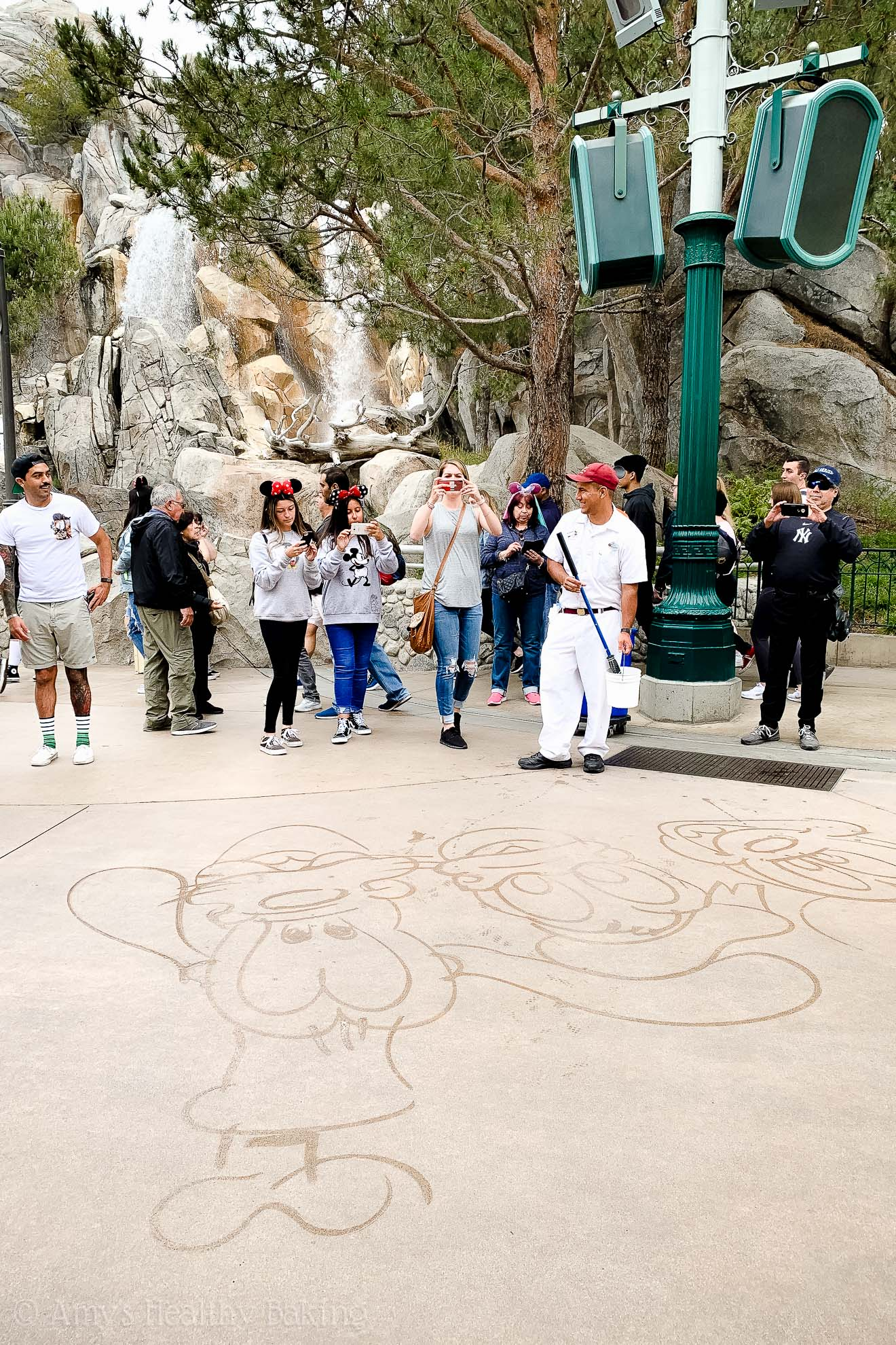 Disney characters drawn in water on the concrete in California Adventure