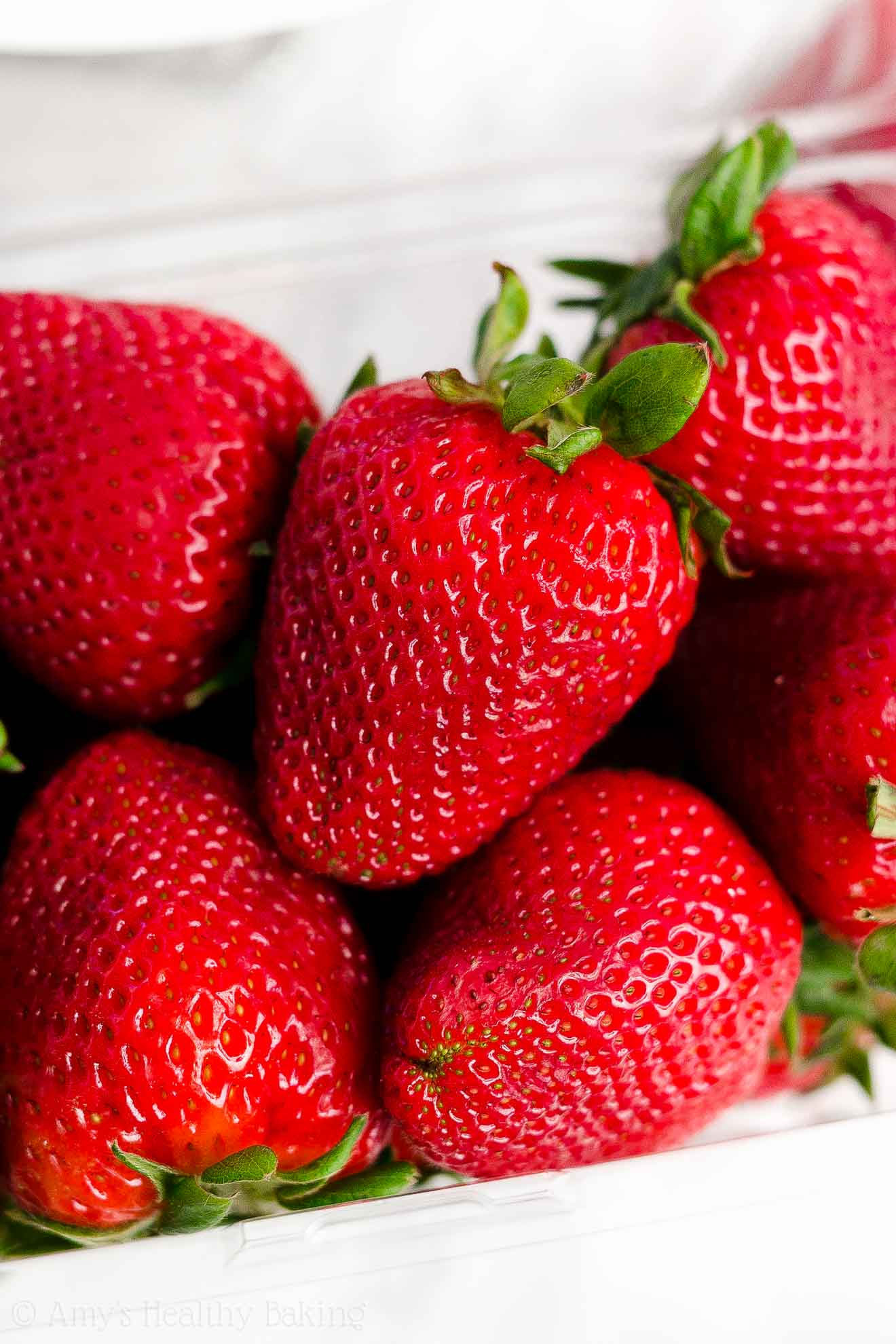 Basket of fresh, ripe, juicy, bright red strawberries