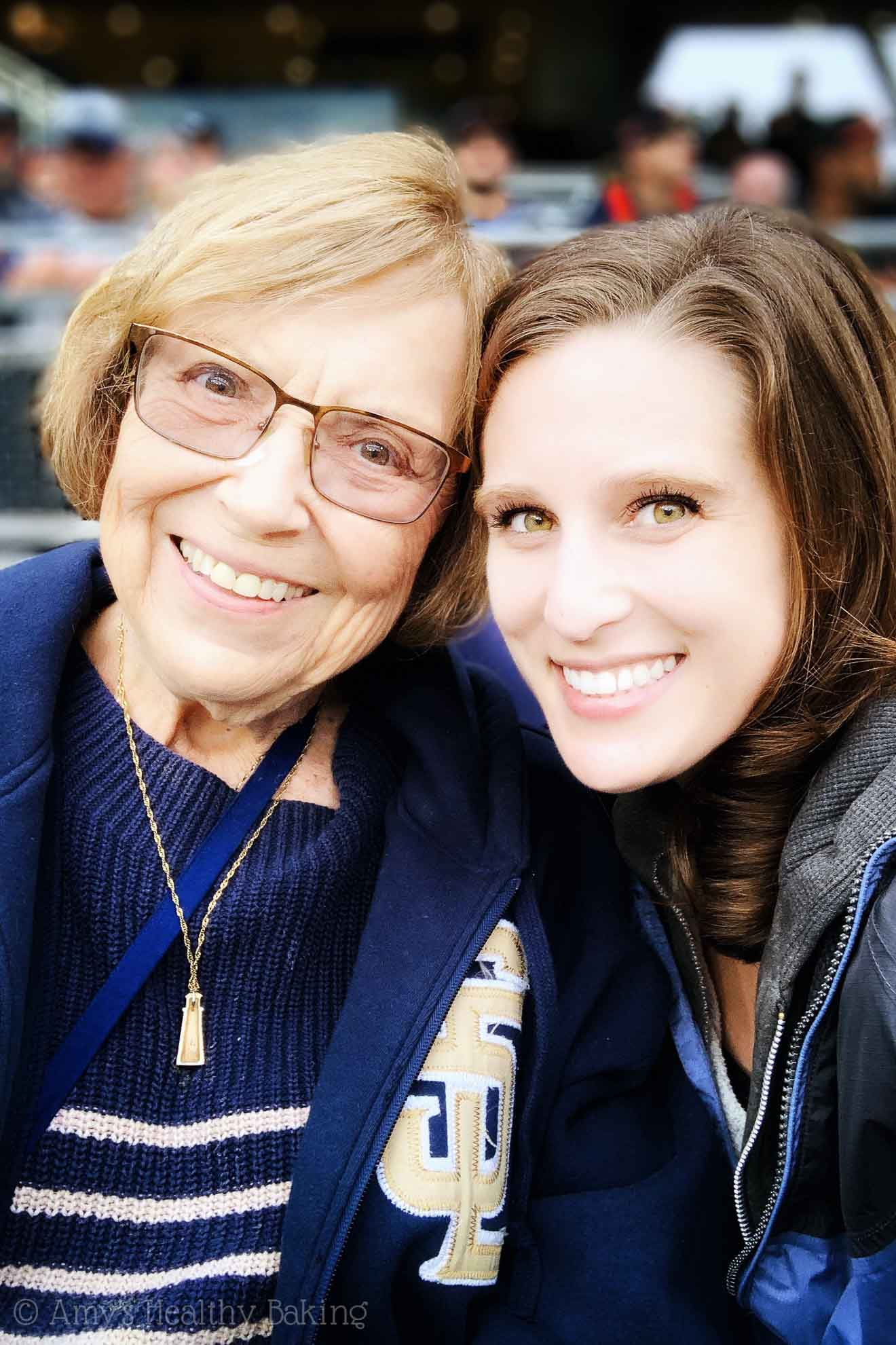 A young adult and her grandmother at a San Diego Padres baseball game