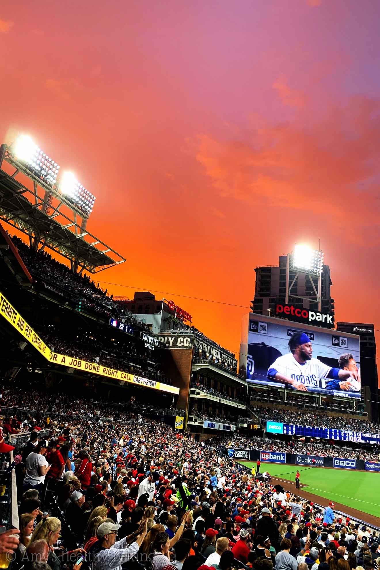 A brilliant pink and orange summer sunset at PetCo Park in San Diego