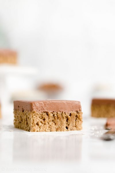 Healthy One-Bowl Flourless Almond Butter Cookie Bars – soft, chewy & 87 calories! Including the chocolate frosting! This recipe is SO easy to make & has NO eggs, butter, oil or refined/powdered sugar too! ♡ vegan gluten free almond butter cookie bars. simple almond butter cookie bars with no sugar and no eggs. low calorie clean eating almond butter cookie bars.