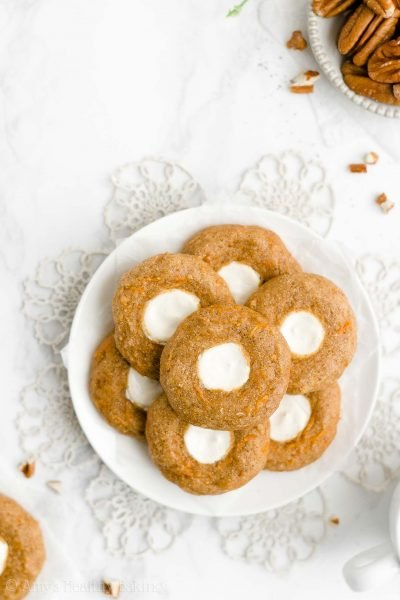 Healthy Carrot Cake Thumbprint Cookies – SO good & just 42 calories! These skinny cookies don't taste healthy AT ALL! Totally perfect for Easter too! ♡ best homemade carrot cake cookies with cream cheese frosting centers. soft chewy carrot cake cookies from scratch. clean eating carrot cake cookies recipe for easter.