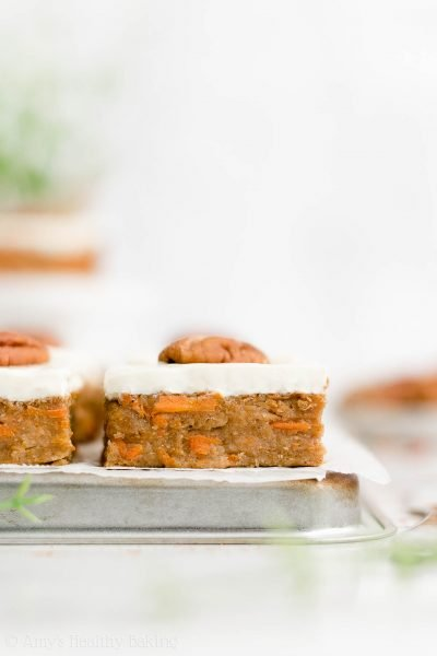 Healthy One-Bowl Carrot Cake Bars – SO good & easy to make! They have the same fudgy texture as brownies! And the yummy cream cheese frosting contains NO powdered sugar! ♡ easy carrot cake bars with cream cheese frosting. clean eating no sugar carrot cake bars. low calorie greek yogurt carrot cake bars.
