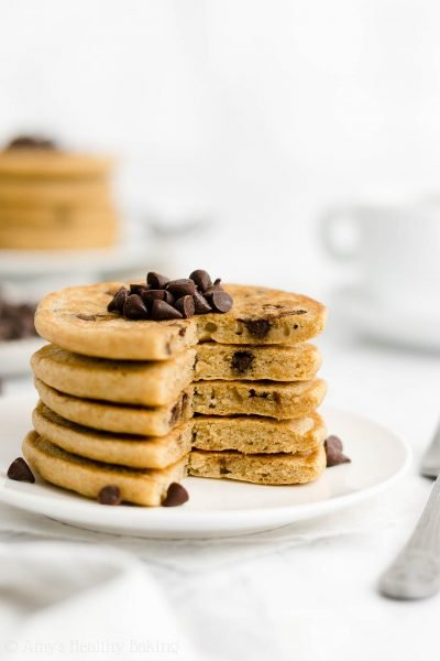 The ULTIMATE Healthy Chocolate Chip Pancakes – fluffy, buttery & SO easy to make! (You just need 1 bowl!) These are the BEST! You'll never use another chocolate chip pancake recipe again! ♡ how to make the best chocolate chip pancakes from scratch. clean eating greek yogurt chocolate chip pancakes. homemade easy fluffy chocolate chip pancakes.