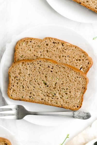 The ULTIMATE Healthy Zucchini Bread – SO moist & tender, even with NO refined flour or sugar! It tastes like you're eating cake, not healthy at all! You just need 1 bowl & a fork to make it too! ♡ moist easy healthy zucchini bread. best ever zucchini bread with greek yogurt. no sugar clean eating zucchini bread.