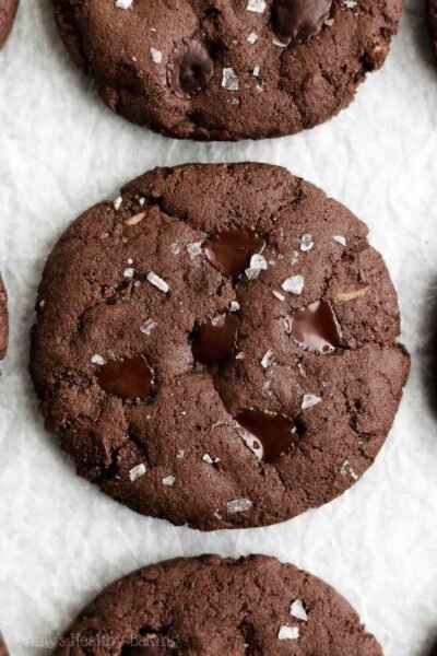 Healthy Chocolate Hazelnut Cookies – soft & chewy with a texture like fudgy brownies! They're SO rich, simple to make & filled with 3 types of chocolate! This easy triple chocolate cookie recipe is naturally eggless, dairy free and vegan… But you'd NEVER know! (There's a fantastic gluten free option for these dark chocolate hazelnut cookies too!)