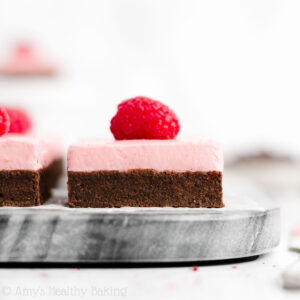 Healthy Fudgy Dark Chocolate Brownies + Raspberry Frosting – only 73 calories, including the frosting! (It's made from Greek yogurt!) This recipe is surprisingly easy to make too! Some of the best brownies I've ever had—they don't taste healthy at all!