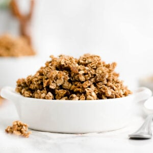 You just need 5 ingredients to make this healthy granola recipe! It's full of cozy cinnamon flavor, lightly sweetened (no white sugar!) & has lots of huge crunchy clusters. Perfect for breakfasts, yogurt parfaits, or simply snacking on by the handful! cinnamon granola recipe easy. healthy granola recipe low sugar. homemade granola healthy low sugar. healthy granola recipe clean eating. homemade granola healthy crunchy. #healthy #glutenfree #granola #breakfast #recipe