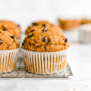 Healthy Pumpkin Chocolate Chip Oatmeal Muffins -- only 128 calories with lots of pumpkin spice! SO moist & tender! Plus they're really easy to make! These are definitely the BEST pumpkin muffins I've ever had! ♡ clean eating greek yogurt pumpkin oatmeal muffins. pumpkin oatmeal muffins with weight watchers points. no sugar pumpkin oatmeal muffins with whole wheat and gluten free options. low calorie sugar free pumpkin oatmeal muffins.